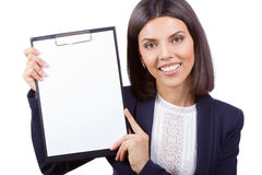Portrait of young business woman with clipboard Stock Photo