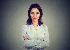 Portrait of young business woman on gray wall background stock photo