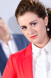 Portrait of young business woman with her colleague at the back Royalty Free Stock Images