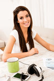 Portrait of a young business woman in her home office Royalty Free Stock Image