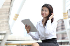 Portrait young business woman with her tablet and smile Royalty Free Stock Image