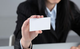 Portrait of young business woman holding blank white business card Stock Image