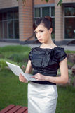 Portrait of young business woman holding notebook Royalty Free Stock Images