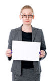 Portrait young business woman holding a white blank banner.  Royalty Free Stock Images