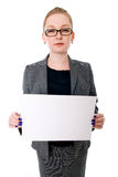 Portrait young business woman holding a white blank banner. Isolated on white background Royalty Free Stock Photos