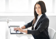 Portrait of young business woman with laptop in the offic Stock Photos