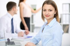 Portrait of a young business woman at meeting. Negotiation concept royalty free stock photo