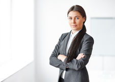 Portrait of young business woman in the office Stock Photography