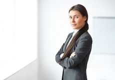 Portrait of young business woman in the office Royalty Free Stock Image