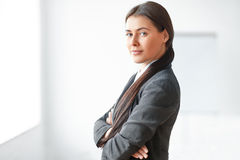 Portrait of young business woman in the office Stock Photos