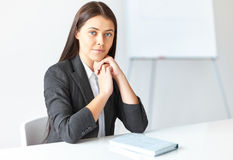 Portrait of young business woman in the office royalty free stock photography