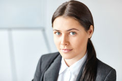 Portrait of young business woman in the office Stock Photo