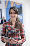Portrait of young business woman at office with team in backgrou Royalty Free Stock Photos