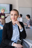 Portrait of young business woman at office with team on meeting Stock Photos