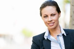 Portrait of business woman smiling outdoor Royalty Free Stock Photos
