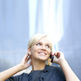 Portrait of a young business woman with a phone Stock Images