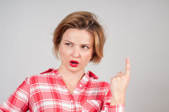 Portrait young business woman with questioning expression royalty free stock photography