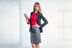 Portrait of young business woman with red folder Stock Image