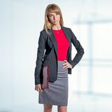 Portrait of young business woman with red folder Stock Photography