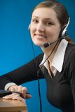 Portrait of young business woman or secretary with headset royalty free stock photo