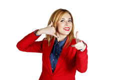 Portrait of young  business woman showing showing hand sign like Royalty Free Stock Image