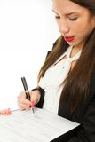 Portrait of a young business woman, signing contract Royalty Free Stock Photography