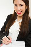 Portrait of a young business woman, signing contract stock image