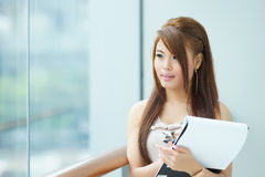 Portrait of young business woman standing near window in modern Royalty Free Stock Photos