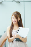 Portrait of young business woman standing near window in modern Royalty Free Stock Photo