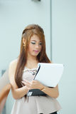 Portrait of young business woman standing near window in modern Royalty Free Stock Image