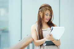 Portrait of young business woman standing near window in modern Royalty Free Stock Photography