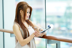 Portrait of young business woman standing near window in modern Stock Image