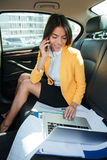 Portrait of a young business woman talking on mobile phone Stock Photos