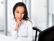 Portrait of a young business woman using computer at office Stock Image