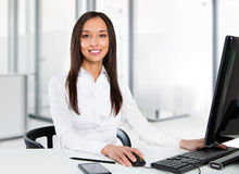 Portrait of a young business woman using computer at office Royalty Free Stock Photography