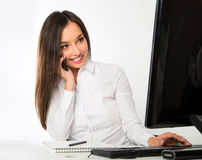 Portrait of a young business woman using computer at office Stock Photos