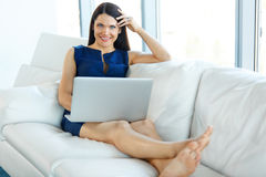 Portrait of a Young Business Woman Using Laptop Computer at Offi Royalty Free Stock Photo