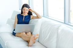 Portrait of a Young Business Woman Using Laptop Computer at Offi Royalty Free Stock Photography