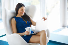 Portrait of a young business woman using laptop at office. Busin Royalty Free Stock Photography