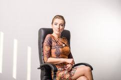 Portrait of a young business woman using laptop at office royalty free stock image