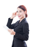 Portrait of young business woman using tablet and thinking Stock Photography