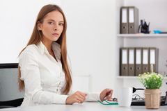 Portrait of young business woman working at her office. Stock Photography