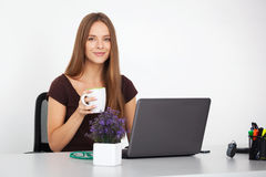 Portrait of young business woman working at her office. Stock Photo