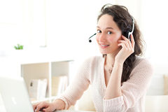 Portrait of young business woman working at home Royalty Free Stock Images