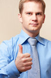 Portrait of a young businessman. Young businessman showing thumbs up sign royalty free stock image
