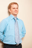 Portrait of a young businessman. Standing against wall stock photos