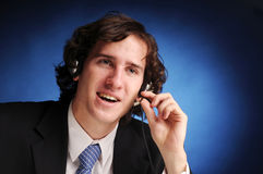 The portrait of young businessman. The portrait of young attractive phoned businessman Stock Photography