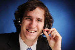 The portrait of young businessman. The portrait of young attractive phoned businessman Stock Photos