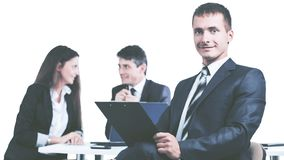 Portrait of a young businessman on background working team royalty free stock photography