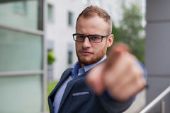 Portrait of young businessman with beard standing in front of of Royalty Free Stock Photography